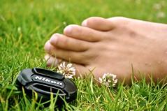Nikon's Foot Fetish (mbendi) Tags: flower feet grass nikon toes maya lenscap bigmomma thechallengefactory