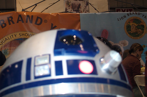 At the Lion Brand Booth: a special visitor! R2-D2!