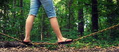 On a tightrope (Absolute Brightness) Tags: trees feet legs chain flipflops