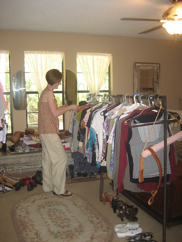 Jennifer putting out clothes