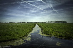 The divided land (Bas Lammers) Tags: blue sky green water netherlands dutch leaves skyline clouds landscape groen blauw waterlily nederland wolken wideangle planes lucht hdr landschap vliegtuig lijnen bladeren waterlelie nieuwkoop canon50d mygearandmepremium mygearandmebronze
