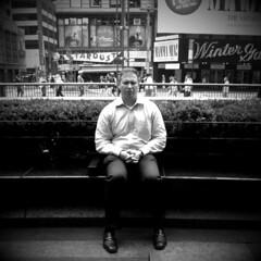 Midtown Meditation (antonkawasaki) Tags: portrait blackandwhite bw bench candid broadway streetphotography zen squareformat bushes theaterdistrict midtownmanhattan 500x500 ellensstardustdiner shrubery iphoneography ©antonkawasaki iphone3gs camerabagapphelgamono blockingouttheoutsideworld midtownmeditation mansittingwitheyesclosedandhandsinterlocked justoutsidecosi rightabovemars2112 mammamiaatthewintergardentheatre peoplewalkingbyinthebackground oraretheyinhismind