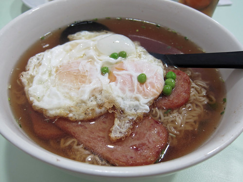 Two Fried Eggs and Luncheon Meat on Instant Noodles Soup