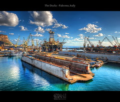 The Docks - Palermo, Italy (HDR) (farbspiel) Tags: ocean travel blue red sea vacation italy holiday colour green rot tourism water colors sunshine yellow clouds docks photoshop logo geotagged photography see harbor nikon colorful ship colours cloudy harbour wolken wideangle bluesky gelb journey blended ita handheld colourful grn blau nikkor palermo dri blauerhimmel hdr highdynamicrange sicilia watermark hdri farben blend sonnenschein w