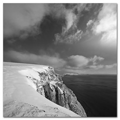 Snow on the Highdown, Freshwater, Isle of Wight (s0ulsurfing) Tags: uk winter england sky blackandwhite bw cliff cloud snow cold english weather clouds danger composition canon square landscape island snowflakes mono 1 coast landscapes frozen interesting dangerous scenery skies britain wide perspective snowstorm january vertigo wideangle monotone cliffs explore coastal edge vertiginous isleofwight british snowing dizzy comparison landschaft isle nube wight compare drift 2010 10mm highdown tennysondown sigma1020 s0ulsurfing artlibre vertorama