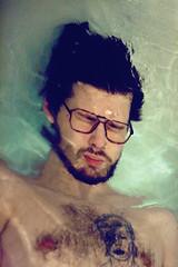 skar (katrinolafs) Tags: boy man water tattoo canon naked 50mm glasses iceland bath underwater chest