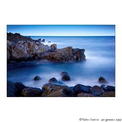 Sicilian sea ... volcanic rocks and crystal clear water. (Binhos) Tags: longexposure blue sea italy seascape color beach water canon landscape volcano rocks italia tripod sicily etna catania sicilia eos5d ef24105l yourwonderland fabiocascio