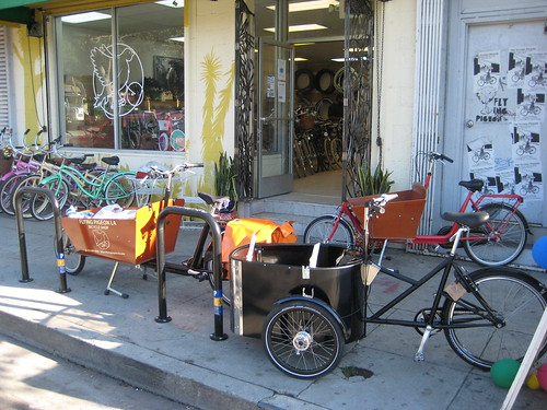 The Flying Pigeon LA shop, your friendly neighborhood mainstream counterculture bike shop! Part of our cargo bike selection is pictured above.