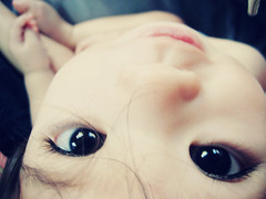 5/52 - your stare. (Wanda (Moved! Add my new account)) Tags: baby eye girl bigeyes wanda eyes child upsidedown little girly innocent adorable cutie stare lit