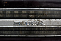 BUICK (Daniel Kulinski) Tags: life old city usa black macro car closeup buick still image zoom muscle 10 metallic object evil samsung american ten create capture approach enlarge magnify proximity closer nx approximate grawl kuliski samsungimaging nx10 samsungnx10 nxten