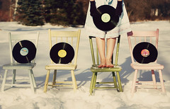 which one should we listen to today? (Emma DiMarco) Tags: trees snow feet colors outside chairs skirt record mittens hbm