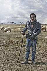 FarmVille (Talal Al-Mtn) Tags: new old blue winter shadow portrait sun man tree canon sand shot desert sheep fb farmville human kuwait talal facebook q8 kwt 450d lm10 inkuwait almtn talalalmtn  bytalalalmtn talalalmtnphotography
