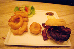 $14 burger and onion rings.