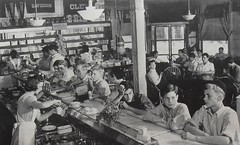 1941 Malt Shop Drug Store Soda Shop Kids Teens Counter Waitress 1940s Americana (Christian Montone) Tags: kids uniform teens 1940s americana waitress 1941 sodajerk luncheonette maltshop vintagephoto sodashop lunchcounter