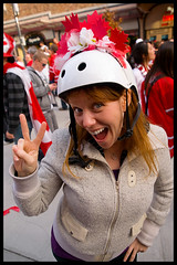 Found a friend in the crowd (Eric Flexyourhead) Tags: winter red party people woman white canada hockey girl smiling vancouver pose fun happy gold friend downtown bc britishcolumbia helmet games victory celebration mapleleaf fans win olympics celebrating granvillestreet 2010 zd 1260mm olympuse3