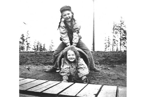 Laura and Miriam Kiehl playing with a barrel, Fort Lawton, Washington