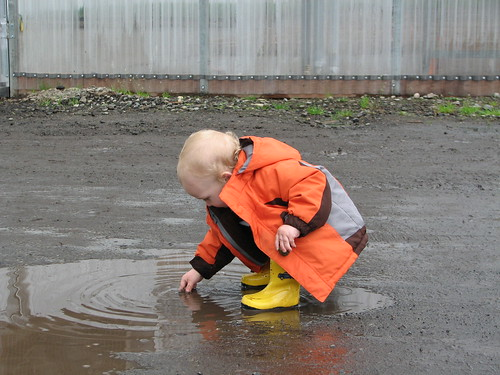 yellow rainboots, baby playing in mud puddle