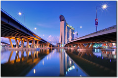 marina bay sands - singapore (fiftymm99) Tags: bridge reflection river hotel nikon highway singapore casino singaporeriver marinabay integratedresort helixbridge fiftymm marinabaysands nikond300 doublehelixbridge fiftymm99 thehelixbridge thedoublehelixbridge bejaminshearesbridge