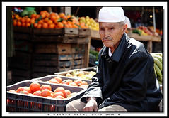 Bouchaib, the Greengrocer - Bouchaib le vendeur de lgumes -      (Rachid Naim) Tags: ocean africa street blue red sea musician mer lagune vegetables hat de rouge eyes sad tomatoes folklore tomates atlantic yeux triste morocco le maroc sacred safi tradition  lgumes rachid  afrique  musicien atlantique greengrocer naim   vendeur  jellaba    tarbouch   oualidia             bouchaib