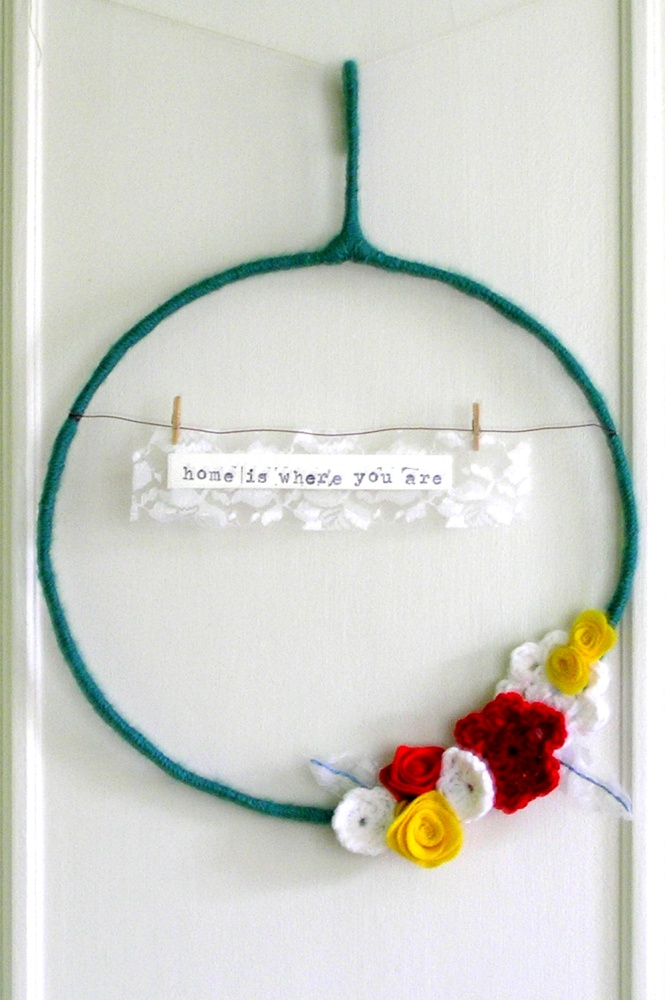 home is where you are - yarn wreath in teal, red, yellow, and white