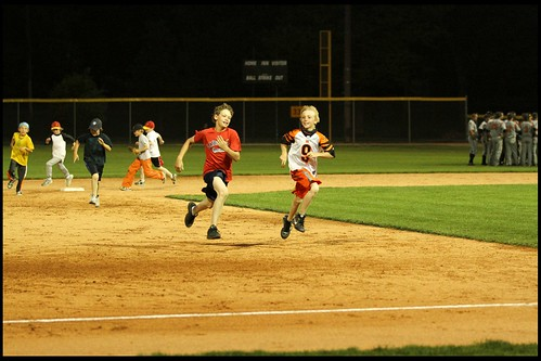 kids run the bases after the game