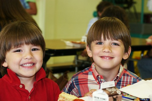 Evan has lunch with Max at school.