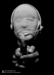 II..II   II..II (Abdulrahman AL-Dukhaini || ) Tags: face 50mm nikon mask internet pistol earphone 2010   abdulrahman          aldukhaini