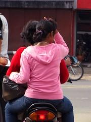 Jakarta streets (Mangiwau) Tags: pink girls streets walking indonesia jay top helmet sidewalk jakarta indonesian pillion cewek