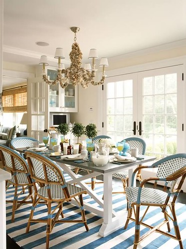 ashley whittaker design breakfast dining room south hampton summer home farm table french bistro chairs blue white sea shell six light chandelier french doors striped ruge carpet.jpg