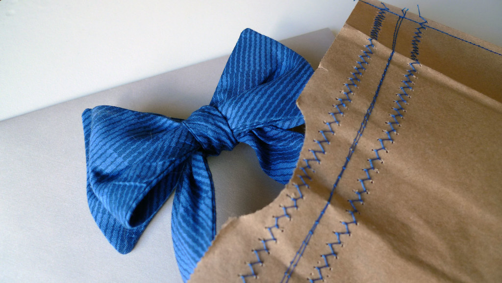 blue bow tie and stitched paper bag