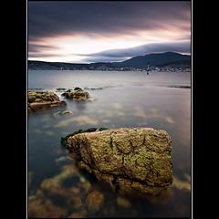 (David Panevin) Tags: longexposure sunset sky bw seascape beach water clouds landscape evening rocks australia olympus tasmania e3 hobart bellerive tessellated sigma1020mmf456exdchsm victoriaesplanade bwnd110 davidpanevin