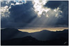 break through (chris frick) Tags: sun backlight clouds snapshot snap rays drama breakthrough mallorca moutains contrasts beams mountainrange fraguel chrisfrick panasonicdmctz5