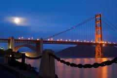 Blue Moon over the Golden Gate (Chris Saulit) Tags: ocean sanfrancisco california bridge light moon reflection water night sunrise dawn bay dusk newyear luna fullmoon explore goldengat