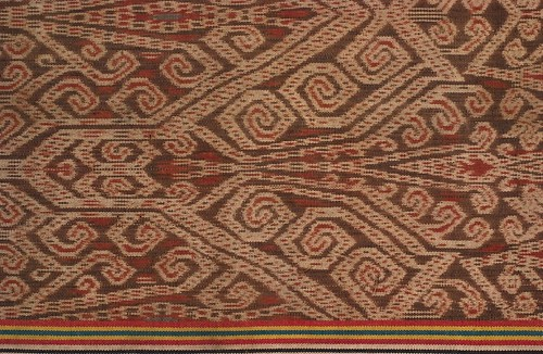 //Bidang// (detail), Iban people. Sarawak, Saribas area, 20th century, 52 x 104 cm. Tangkong motif, ikat technique. From the Teo Family collection, Kuching. Photograph by D Dunlop.