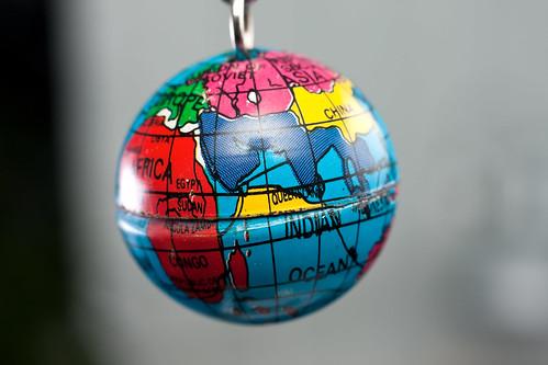 Macro of tiny Earth globe hanging on key chain