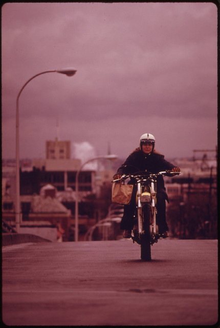 Motorcycles Came Out of Summer Vacation Retirement During the Fuel Crisis in the Pacific Northwest During the Fall of 1973. This Person Is Riding in Portland 11/1973