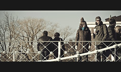 Starbucks in Hand (Nick Keating) Tags: park city bridge winter urban film boston canon ma couple walk massachusetts january cinematic tone publicgarden 30d nickkeating