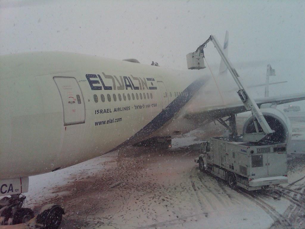 EL AL flight being de-iced at Newark Airport