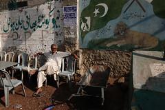 Displaced loyalties (Kohi Marri) Tags: karachi sindh manoraisland canoneos1dsmarkiii pakistanstreetshots canonef24mm14lii