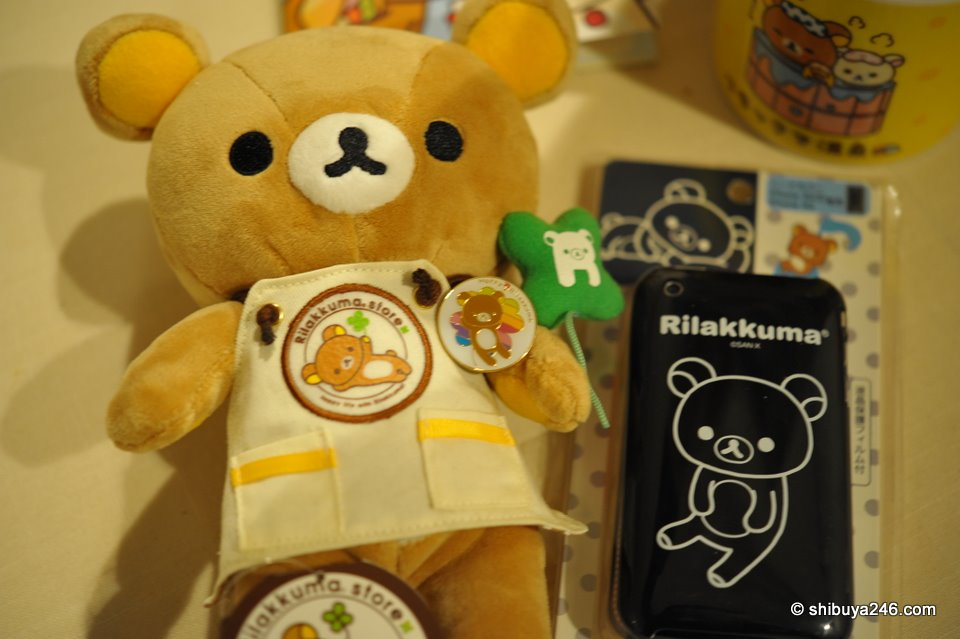 The back of the hard cover iPhone case has a full body design of Rilakkuma. The other 2 colors available just show the face. Apparently the black version is quite popular.