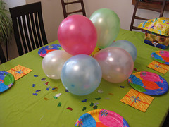 table with balloons and confetti, etc.