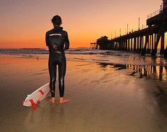 Waiting . . . (Sandra Leidholdt) Tags: surfer surfing california sunset pier beach coast pacific dude sports wetsuit southerncalifornia orangecounty huntingtonbeach huntingtonbeachpier leidholdt ocean surfdudes sandraleidholdt sandyleidholdt surfboard board ripcurl surfwear ripcurlwetsuits explore explored
