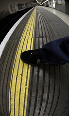 Breaking the rules (jonhaywooduk) Tags: london underground tube photocrit darephoto donotcrosstheyellowline feetoffseats