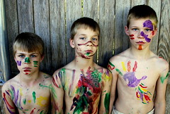 Art (Reagan Thomson Photography) Tags: color art boys playground kids fence three kid artwork eyes war paint child bare chest trouble messy stare