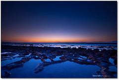 So High (Zakaria Salhi) Tags: sunset sky seascape water colors rock landscape nikon sigma morocco filter maroc polarizer paysage 1020 rabat d300 cokin 77mm lapislazuli gnd singhray moroccanbeach goldnblue zakariasalhi