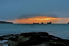 A pocket of light (Eyesplash - What happened to winter) Tags: light sunset seagulls coast rocks pacific ships ubc utata englishbay pocket tourbeautifulbc