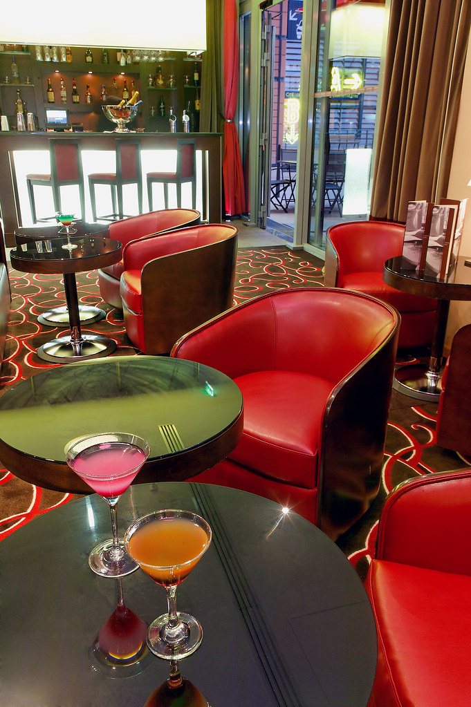 Cool red circle patterned carpet with red couches at the Back Stage Bar the Hotel de la Cité , Lyon , France