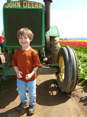 Posing With The John Deere (Catcher & Co.) Tags: tractor oregon play catcher johndeere tulipfest woodenshoetulipfarm