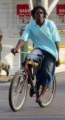Wandering Dread (Legin_2009) Tags: road street man motion black male men guy bike bicycle shirt dreadlocks movement cyclist ride african guys jeans riding jersey males locks caribbean shorts dread poloshirt rider polo mnner hombres mec dreds  mecs  gason    hommes homens