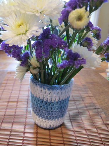 Crocheted jar vase with flowers
